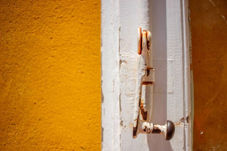 Close-up of rusty door knocker