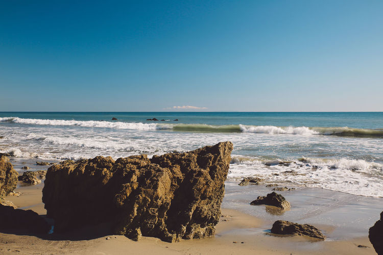 California El Matador Beach Pacific Beach Beauty In Nature Blue Clear Sky Day Horizon Over Water Nature No People Ocean Outdoors Rock - Object Sand Scenics Sea Sky Sunlight Tranquility Water Wave