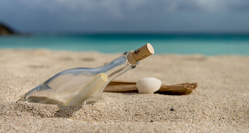 Message in a bottle Beach Beauty In Nature Bottle Close-up Communicate Day Horizon Over Water Letter Mail Message Message In A Bottle Nature No People Outdoors Sand Sea Seashell Shore Sky Water EyeEmNewHere