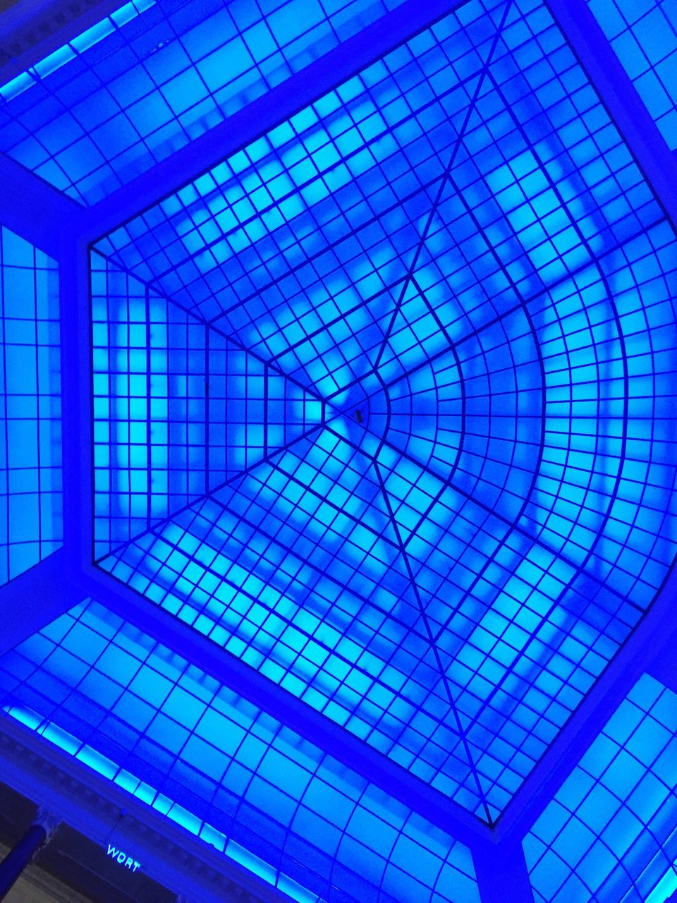 ceiling, pattern, illuminated, indoors, abstract, no people, blue, backgrounds, built structure, complexity, multi colored, architecture, modern, neon, close-up, day