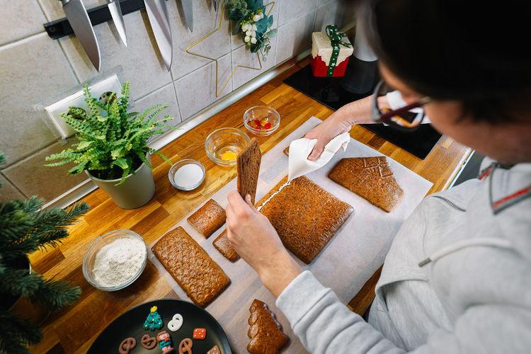 High angle view of woman having food at home