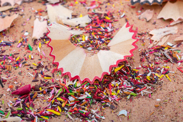 Colorful pencil shavings on a brown background Colors Art Arts Culture And Entertainment Drawiing Education Pencil Pencil Shavings Shaving