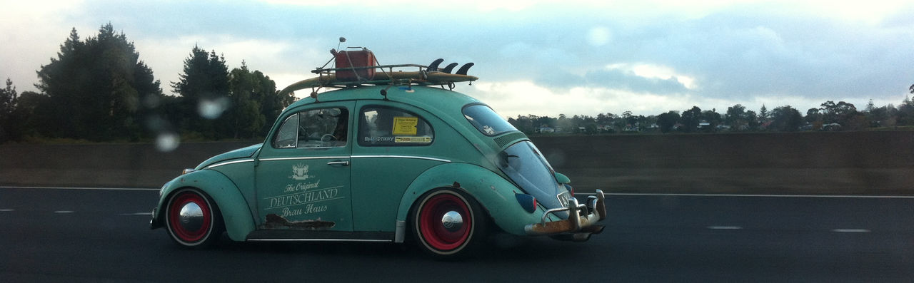 Car Cloud - Sky Day Land Vehicle Mode Of Transport Motion Motor Vehicle No People Old-fashioned On The Move Outdoors Parked Rat Road Side View Sky Small Stationary Street Tail Light The Past Transportation Travel Vintage Car VW Beetle