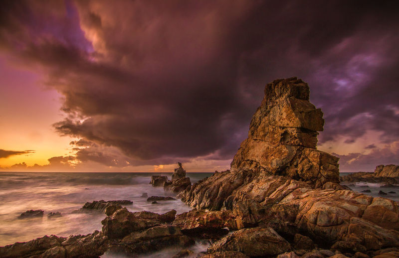 sunset vibes Beach Beauty In Nature Cloud - Sky Day Dramatic Sky Horizon Over Water Nature No People Outdoors Power In Nature Purple Rock Rock - Object Rock Formation Scenics Sea Sky Storm Cloud Sunset Sunset_collection Sunshine Tranquil Scene Tranquility Water Wave