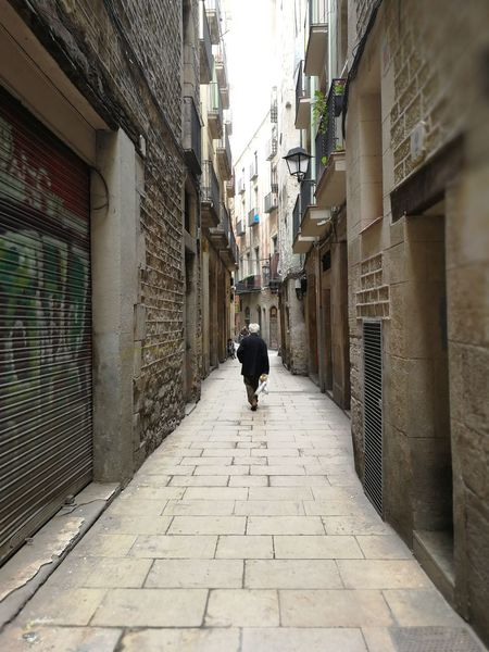 A elderly man walk slowly Alone Barcelona Building Elderly Gaudi Historical Building Man Old Old Man Path Photo Photography SPAIN Stone Walk Walking Around