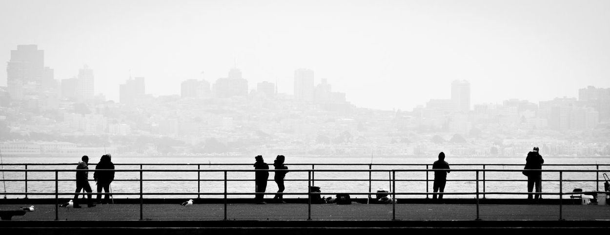 San Francisco Outdoors City Life Real People Day Cityscape Water Urban Skyline Skyscraper City Building Exterior Architecture Black And White Fishing Fog