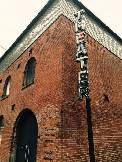 Old brick building turned theater Brick Wall Historical Building