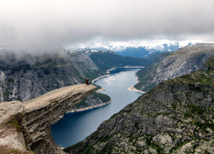 Edge Hiking Nature Norway RISK Rock Scandinavia Adventure Beauty In Nature Cliff Day Hike Landscape Landscapes Mountain Mountains Outdoors Scenics Sky Tranquil Scene Trolltunga Viewpoint Water
