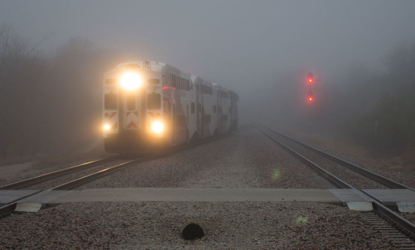 TRE train emerging from the fog. Capture The Moment Foggy Morning Foggy Weather Mode Of Transport Passenger Trains Rail Transportation Railroad Track Red Light Sky Train - Vehicle Train Tracks Transportation Transportation