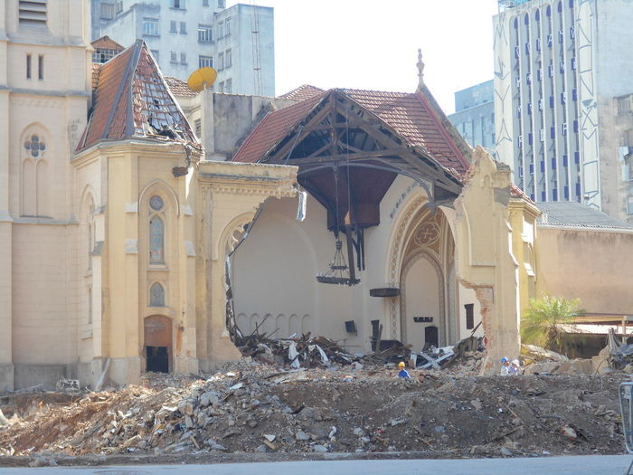 Day 21. Building Collapse: Inner City Calamity in downtown São Paulo at Largo do Paissandú; 3 am May 1, 2018. The abandoned former Federal Police steel and glass skyscraper, which had been invaded by street people, imploded in the early morning hours and the neighboring buildings, including the Lutheran Church on Avenida Rio Branco, were destroyed by fire as well. This photo, taken May 21, 2018 captures a close-up view of the damage to the Lutheran Church, one of the casualties from the building implosion located next to it. The street barriers had recently been moved by the authorities to permit a closer view of the inside damage to the church from street level. Avenida Rio Branco Current Events God Hurts Largo Do Paissandu May 1, 2018 May 21, 2018 Street View Susan A. Case Sabir Unretouched Photography A Test Of Faith Building Collapse Building Implosion Buildinng Fire Controlled Chaos Debris Removal Downtown São Paulo Implosion It Could Have Been Worse Not Totally Destroyed Place Of Worship Religion Responsiveness Urban Photography Urban Strife Work-in-progress