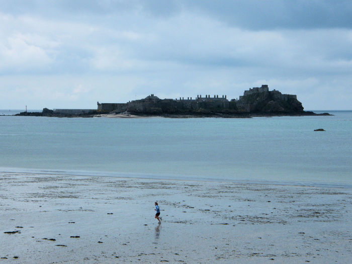 Elizabeth Castle, Jersey St Helier Beach Beauty In Nature Cloud - Sky Day Full Length Horizon Over Water Leisure Activity Men Nature One Person Outdoors People Real People Sand Scenics Sea Shore Sky Standing Tranquility Water Lost In The Landscape