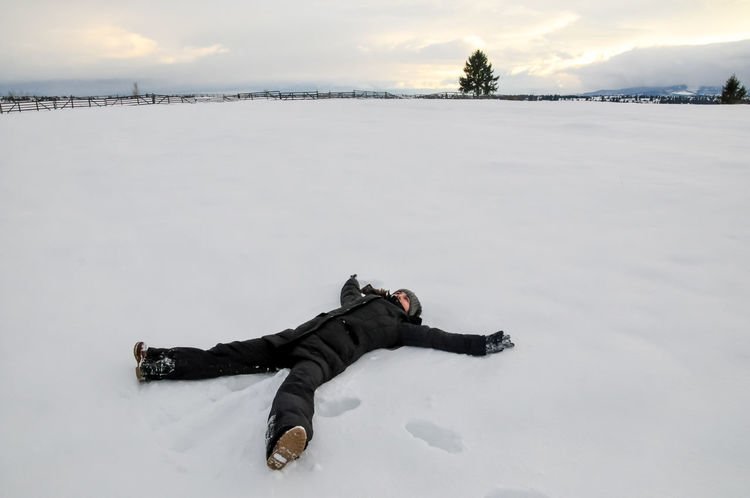 Laying in the snow, waiting for the sunset Carpathian Mountains Fun Playing In The Snow Transilvania, Romania Travel Winter Landscapes Winter Landscape Woman Cold Temperature Countryside Frozen Laying On The Ground Lying Down Making Snowangels Nature One Person Outdoors Sky Snow Warm Clothing Winter Young Adult Shades Of Winter Inner Power