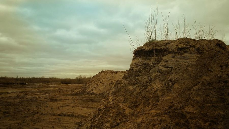 Wasteland in June Wasteland Surgut Wasteland Outland Landscape Desertscapes Wastelandscape Sky Clouds Cliff Barren Land No Man's Land No People Outdoors Soft Colors  Arid Landscape Sand Dune