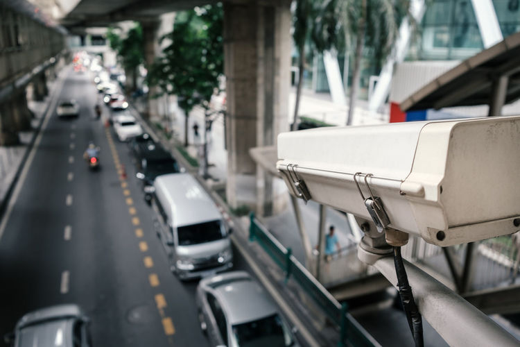 Outdoor security cctv camera in traffic, view from skywalk