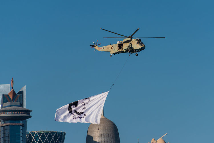 Doha Helicopter Qatar National Day Blue Clear Sky Day Flag Flying Low Angle View No People Outdoors Qatar Sky