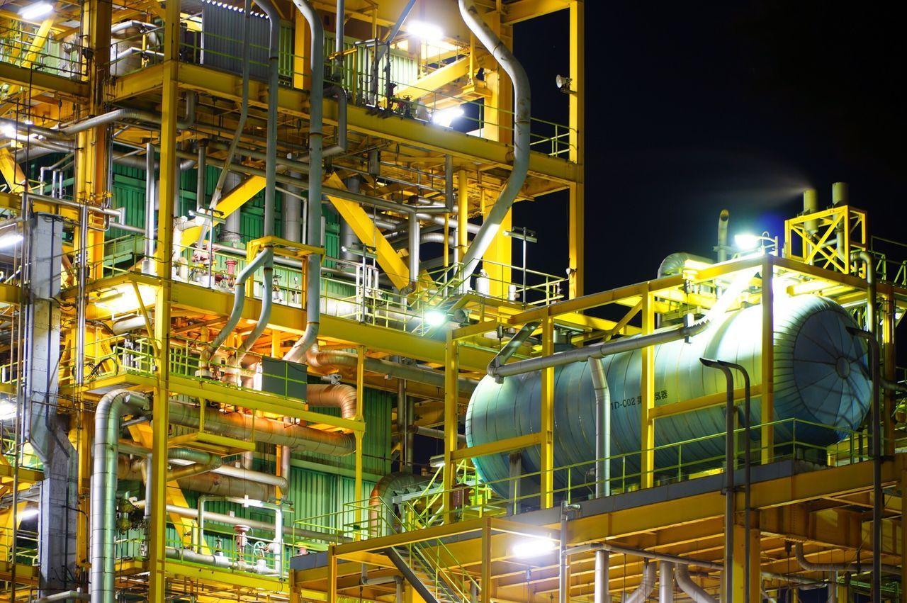 Illuminated industrial building at night