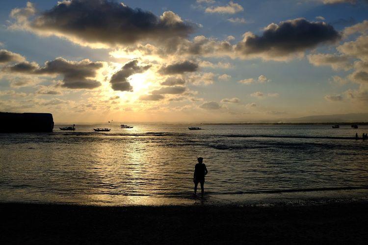 Senja itu sungguh indah, maka nikmat mana lagi yang kamu dustakan Fujifilm Fujifilm Xt20 Fujinon 23mm F2 Terfujilah Visitindonesia EyeEm Gallery EyeEm Best Shots Eye4photography  EyeEm Water Sea Sunset Beach Silhouette Full Length Sunlight Standing Reflection Sky