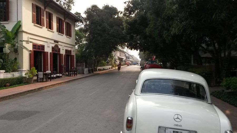 Luang Prabang City South East Asia Architecture Building Building Exterior Built Structure Car City Day House Land Vehicle Landscape Luang Prabang Mode Of Transportation Motor Vehicle Nature No People Outdoors Plant Road Street Transportation Tree