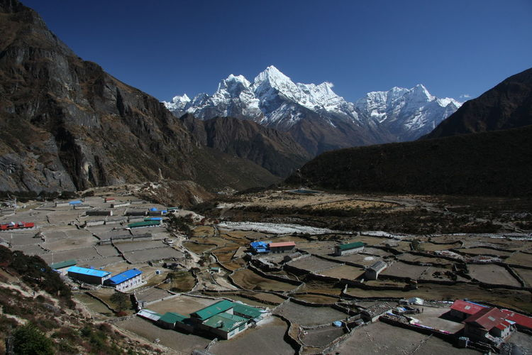 High angle view of snowcapped mountains against sky from thame, namche bazaar