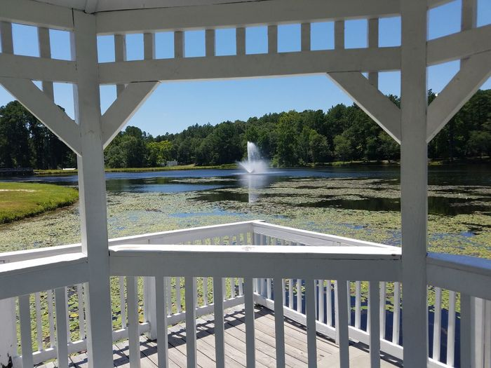 Gazebo At The Park Sky And Clouds Water Fountain Lake View Lakeside Summertime Showcase July 43 Golden Moments Lovely Weather No People Outdoor Photography Enjoying The Sun Lillypads Reflections In The Water Hidden Gems