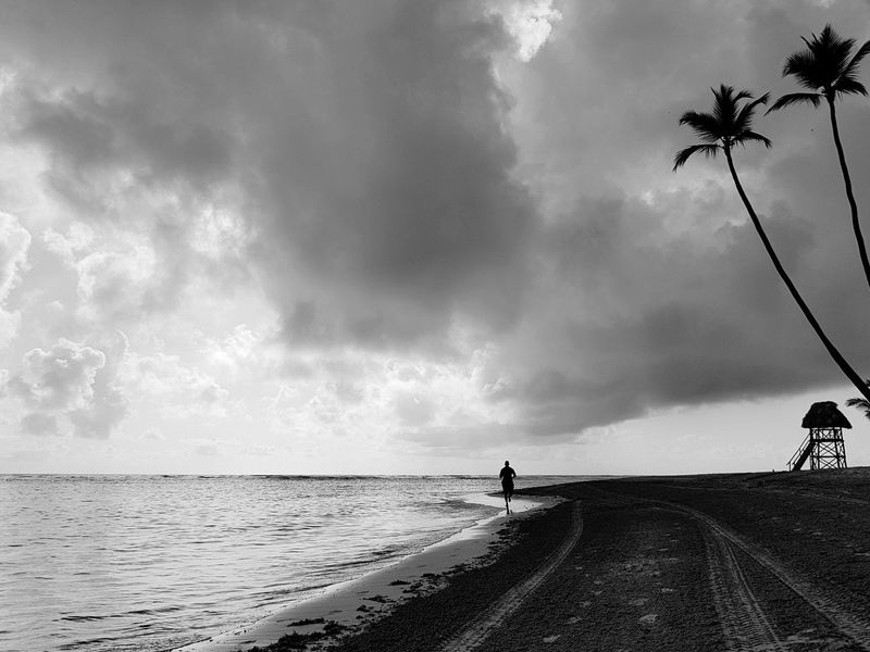Black And White Friday Water Beach Cloud - Sky Sea Sky Punta Cana, Dominican Republic Ash Summer One Person Morning Running Runner Sport Landscape Palm Tree Travel Destinations Only Men Outdoors