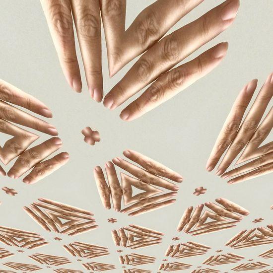 Kaleidoscoping pattern on human hand
