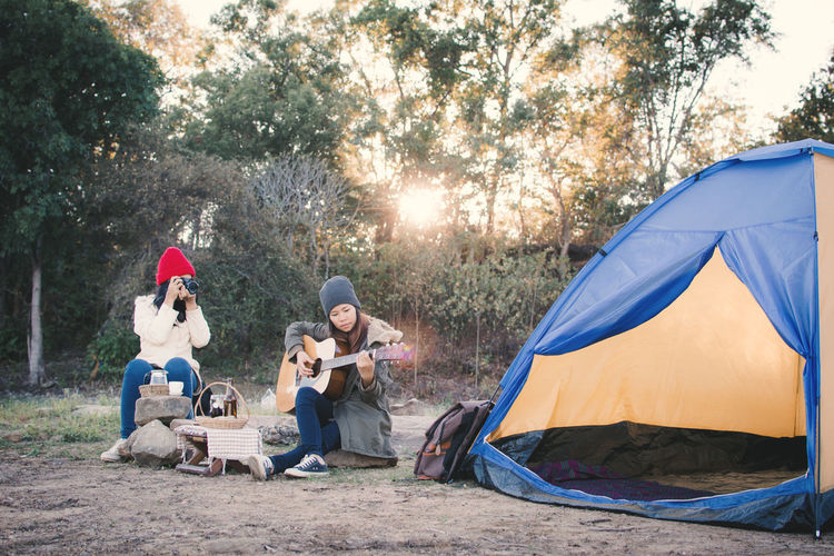 Camera Camping Happiness Joyful Relaxing Vacations Woman Guitar Play Sunset Tent Fresh On Market 2018