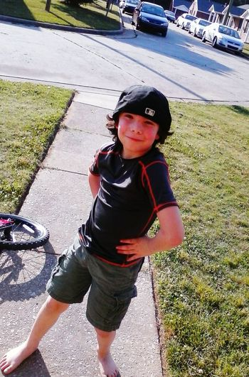 My Son Playingoutdoors on a Summer Day, Bike riding Striking A Pose