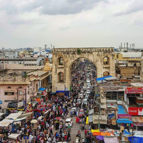 Large Group Of People Crowd Outdoors Travel Destinations Vacations Art Is Everywhere Scattered Bustling City City Street Urban Exploration Second Acts Hyderabad Heritage Art And Architecture Charminar