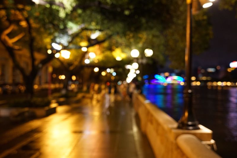 Close-up of illuminated street light in city at night