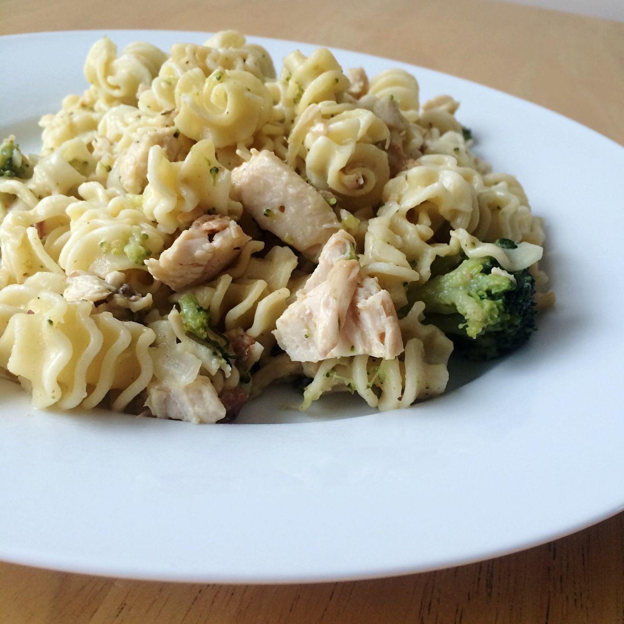 Close-Up Of Chicken Meat And Vegetable Pasta On Plate