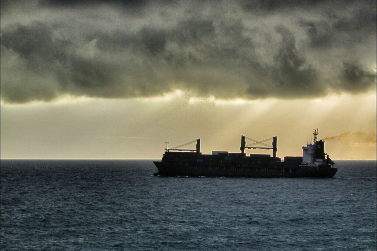 sea, sky, water, cloud - sky, waterfront, tranquility, no people, horizon over water, nautical vessel, transportation, rippled, silhouette, nature, outdoors, scenics, day, freight transportation, beauty in nature, storm cloud, architecture, sailing, offshore platform
