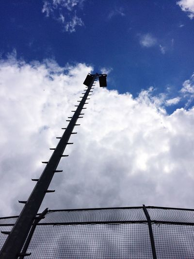 Low Angle View Sky Clouds And Sky Clouds Day Outdoors Weather Nature Overcast Lightpole Baseball Softball Backstop