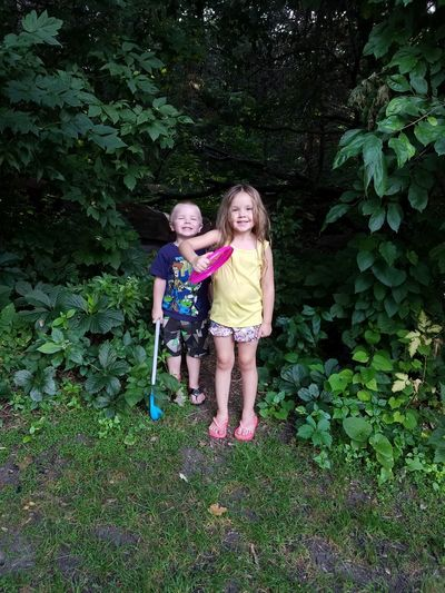 Childhood Front View Day Child Full Length Togetherness Happiness Two People Standing Smiling Summer Outdoors Leisure Activity Green Color Grass People Looking At Camera Children Only Nature South Dakota Summer Memories 🌄 No Filter, No Edit, Just Photography Garretson Garretson Sd Palisades