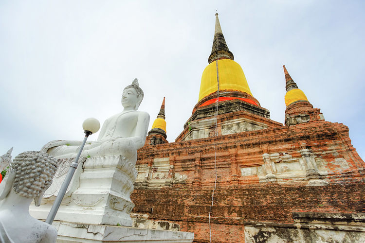 Ancient pagoda and the Buddha image in Wat Yai Chai Mongkhon, Ayutthaya province, Thailand. Ancient Ayutthaya Pagoda Stupa Thai Thailand Travel Wat Yai Chai Mongkhon Architecture Building Built Structure History Place Of Worship Religion Temple Travel Destinations