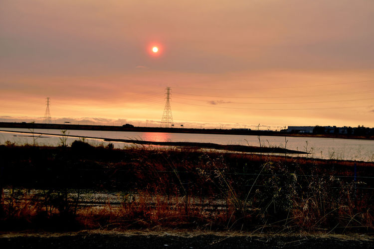Sunset At Eden Landing 13 Marsh Tidal Wetlands Restored Marshlands Eden Landing Ecological Reserve Wildlife Refuge Salt Pond Sundown Sunset Sunset_collection Sunset Silhouettes Power Pylons & Lines Telephone Poles Buildings Sun's Glow Reflection Reflections In The Water Mudflats Lowtide  Nature Nature_collection Beauty In Nature Landscape_Collection Landscape Landscape_photography Fog Marine Layers! Foggy Reed - Grass Family Horizon Over Water Dramatic Sky