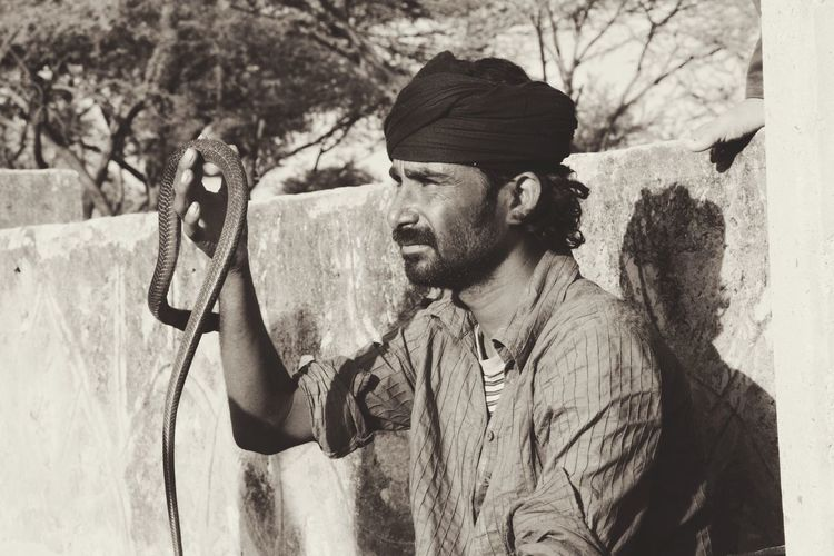 e charmer holds his cobra to attract the attention of passers bye in Pushkar. India Portrait Noir People People Photography First Eyeem Photo