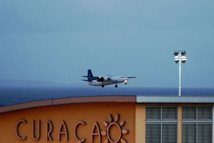 Curacao Airport Hato Airport Take Off Airplane Airport Blue Built Structure Curacao Day Early Morning Flying Low Angle View Outdoors Sea Transportation