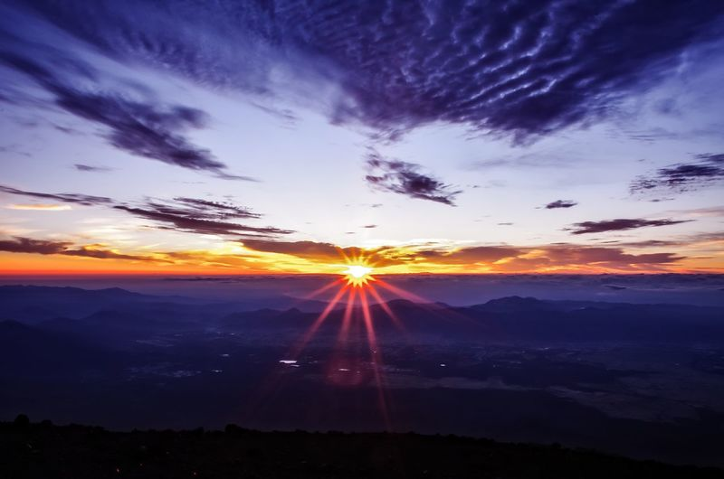 Overnight Success Scenics Tranquil Scene Sunset Beauty In Nature Mountain Sun Tranquility Idyllic Landscape Sunbeam Nature Sunlight Non-urban Scene Tourism Cloud - Sky Majestic Travel Destinations Lens Flare Remote Dark 今を生きる EyeEm Nature Lover Mtfuji