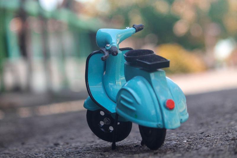 Blue toy car on street