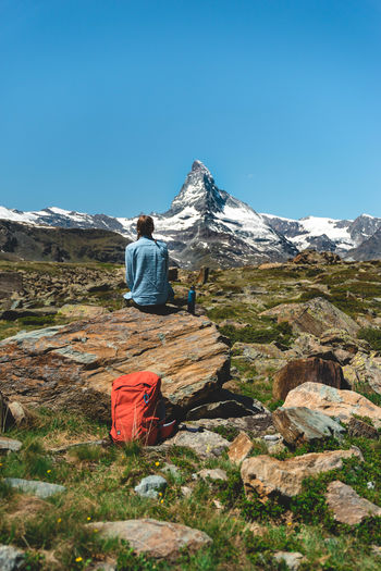 Matterhorn  Matterhorn Zermatt Adult Adventure Beauty In Nature Clear Sky Cold Temperature Day Full Length Hiking Lifestyles Mountain Mountain Range Nature One Person Outdoors People Real People Rear View Scenics Sky Snow Snowcapped Mountain Switzerland