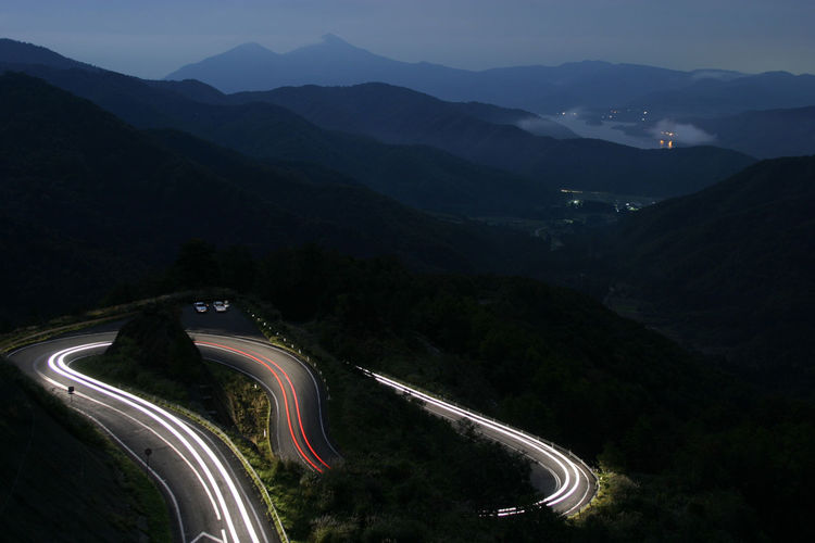 landscape japan fukushima bandaiazuma Beauty In Nature Car High Angle View Illuminated Land Vehicle Light Trail Long Exposure Mode Of Transportation Motion Motor Vehicle Mountain Mountain Range Mountain Road Nature Night No People Outdoors Road Scenics - Nature Transportation Winding Road