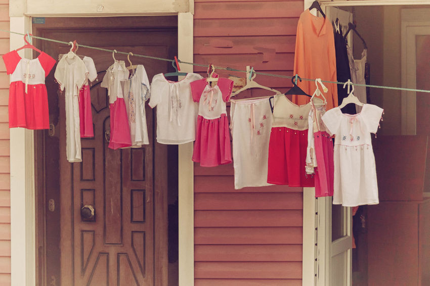 Cotton Dresses Abundance Arrangement Close-up Clothesline Clothing Line Clothing Shop Cotton Day Group Of Objects In A Row Kids Wear, Dress, Summer, Cotton, Cotton Dress Large Group Of Objects Multi Colored No People Red Repetition Shop Shopping Side By Side Summer Dresses Variation