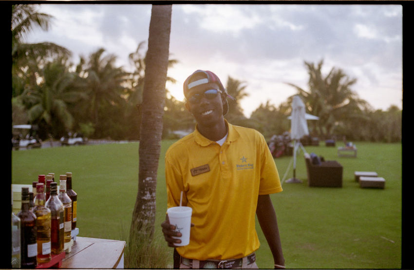 Free cocktails on the driving range! Bahamas Bakers Bay Cocktails Drink EyeEm Best Shots Film Film Photography Filmcamera Filmisnotdead Friend Golden Hour Golf Golfing Grass Green Nikkormat FS (1965) Palm Trees Showcase April Sun Sunset Tadaa Community Taking Photos Taking Pictures Tree Walking Around