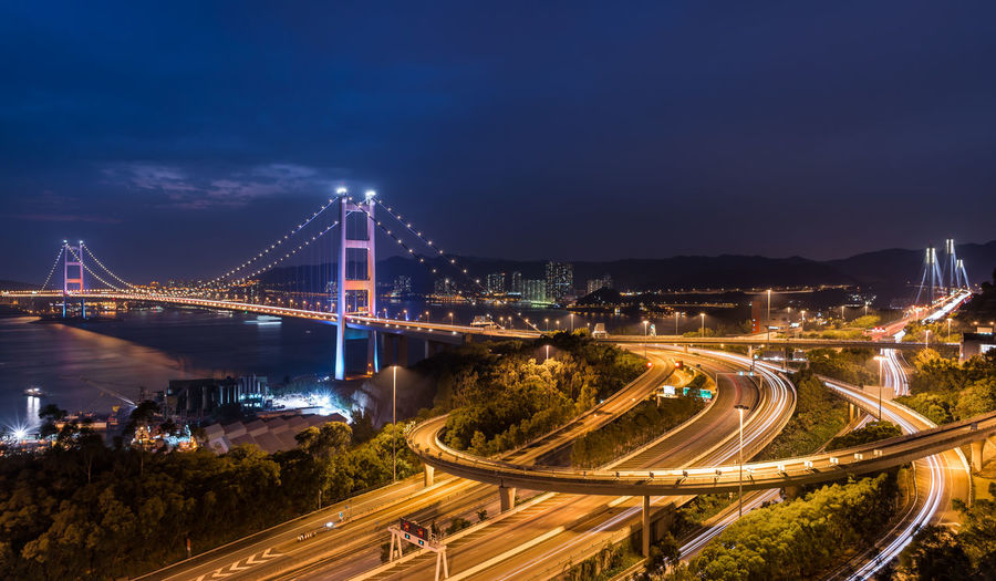 Tsing Ma Bridge Architecture Blue Bridge - Man Made Structure Built Structure Business Finance And Industry Car City City Life Cityscape Connection Downtown District Highway Illuminated Light Trail Long Exposure Mode Of Transport Motion Neon Night Speed Suspension Bridge Traffic Transportation Travel Travel Destinations