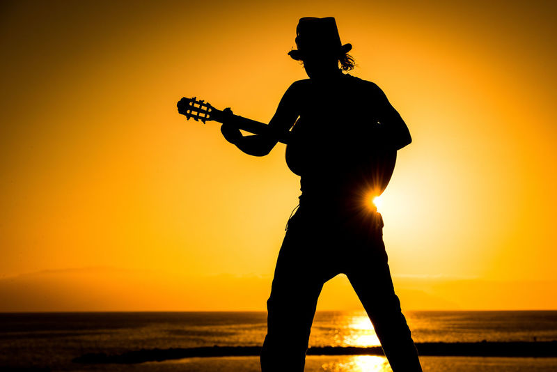 Guitar Hero Canarias Canary Islands Silhouette Silhouettes Sunset Silhouettes Sunset_collection Guitar Guitar Player Guitarist Guitarporn One Person Orange Color People Real People Silhouette Silhouette Photography Silhouette_collection Silhoutte Photography Standing Sunset Sunsetlover Sunsets Tenerife Tenerife Island Teneriffa