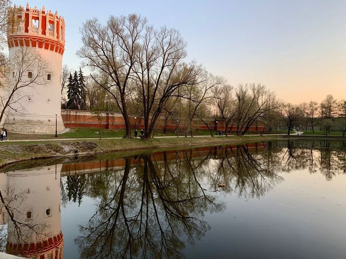 Reflection Tree Sky Plant Architecture Water Built Structure Building Exterior Nature Building Bare Tree Lake Waterfront No People Park Day Tranquility Outdoors Scenics - Nature Moscow Novodevichy Monastery Novodevichy Ponds Springtime Decadence The Architect - 2019 EyeEm Awards