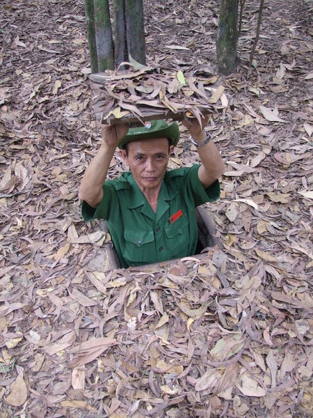 Surprise! Cu Chi Tunnels Composition Day Daydreaming Dead Leaves Front View Full Frame Head And Shoulders High Angle View Ho Chi Minh City Leisure Activity Looking At Camera Outdoor Photography Portrait Saigon Smiling Soldier Standing Surprise! Tourism Tourist Attraction  Uniform Unusual VietCong Vietnam War