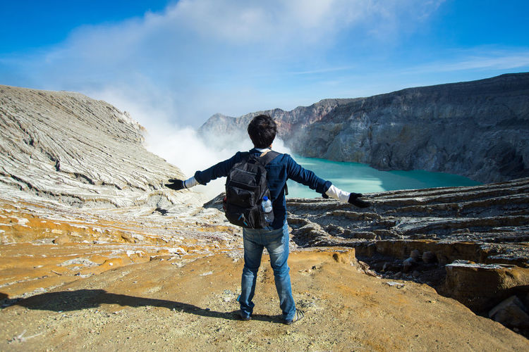 INDONESIA Travel Beauty In Nature Cloud - Sky Environment Full Length Kawah Ijen Leisure Activity Lifestyles Men Mountain Mountain Range Nature Non-urban Scene One Person Outdoors Real People Rock Rock - Object Scenics - Nature Sky Solid Standing Water