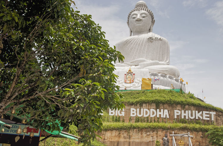 The Big Buddha site at Phuket, Thailand ASIA Big Buddha Phuket Thailand Architecture Day Effigy Low Angle View Nature No People Outdoors Religion Sculpture Sky Spirituality Statue Tree